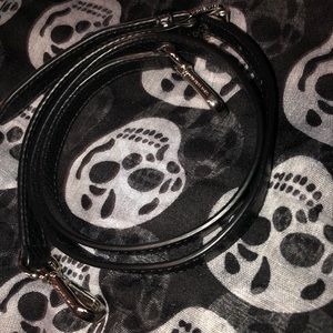 Black Michael Kors crossbody purse strap